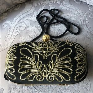Black and gold cocktail purse. 6.5 in x 3 in.